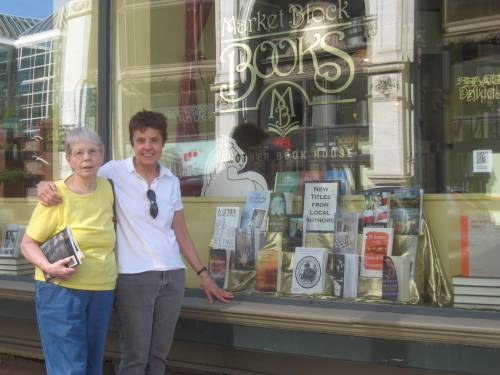 Market Block Books show window with Piping Rock novel featured